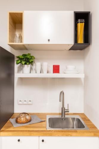 LivinnX Kraków – 2 – person unit with mezzaine beds Kitchen