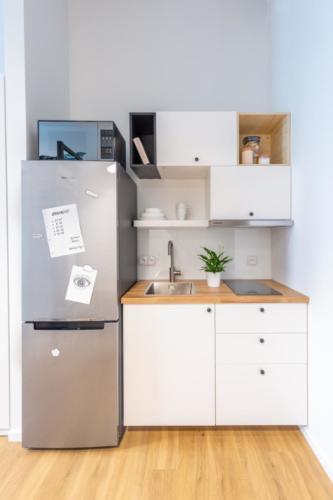 LivinnX Kraków –2 – person unit with mezzaine beds kitchen